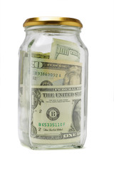 US dollar bils in glass container