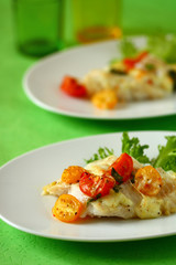 Baked fish fillet  with tomato