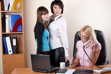 three charming females at office