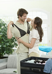Happy couple packing