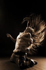 cool woman modern dancer against black