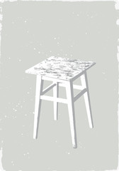 backless stool on a grey