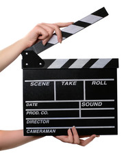 Two hands with a movie clapper board open. Isolated over white b