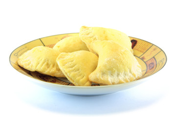home made biscuit filled with marmalade isolated on white