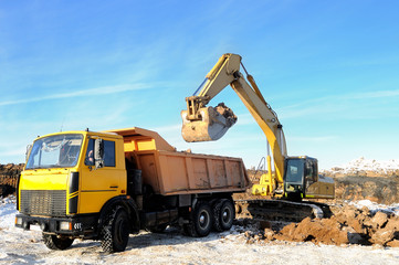loader excavator and rear-end tipper