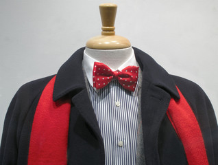 Dark coat with red scarf and bowtie