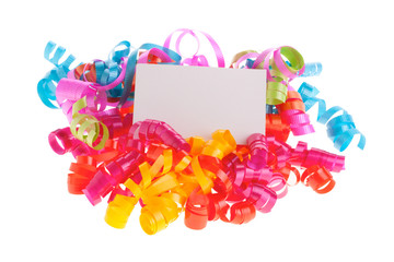 Blank white card on curly ribbons