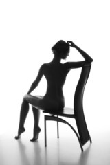Silhouette of a beautiful young woman sitting