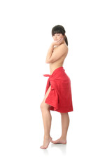 Nude female covered with red towel