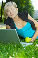 Businesswoman using laptop outdoor