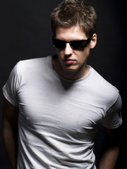 Handsome young male model wearing sunglasses