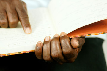 afro man reading his journal