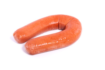 a nice brown and shiny sausage isolated over white