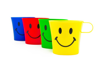 Colour cups with drawing in a kind of smile