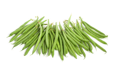 many raw green  beans isolated over white