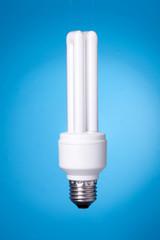 Energy saving lamp on blue background