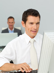 Confident businessman working at a computer