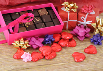 Red and white gift box with ribbons for love