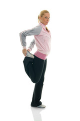 Young women stretching quadriceps