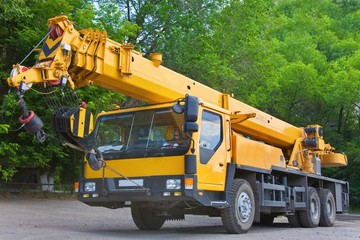 Heavy mobile yellow auto crane .