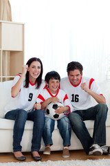 Lively famil ywatching football match