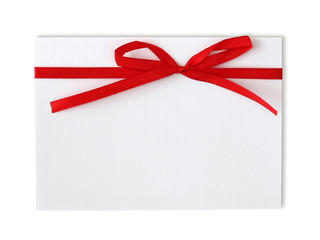 Blank note and red ribbon isolated on white background