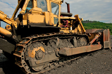 Industrial image of a bulldozer at a coal mine.