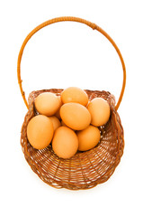 Basket full of eggs isolated on white