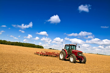 Wall Mural - Tractor in plowed field