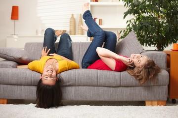 Happy teen girls resting