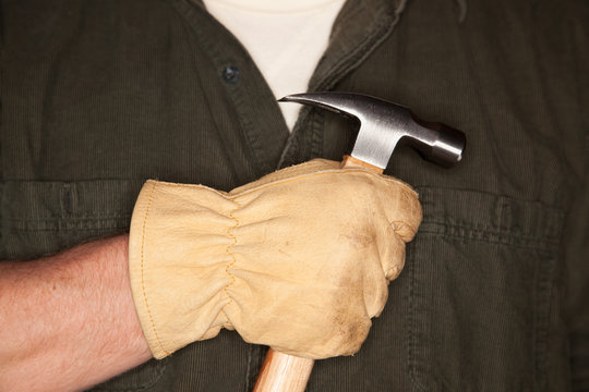 Man with Leather Construction Glove Holding Hammer
