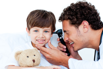 Smiling doctor examining patient's ears
