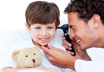 Attractive doctor examining patient's ears