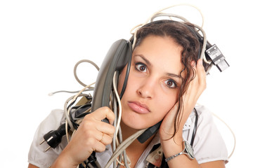 Woman phoning tangled with cables
