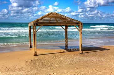 Sea shore and wooden sun shelters, Netanya, Israel
