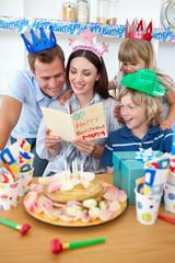 Joyful family celebrating mother's birthday