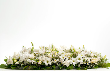 photo of white table flower decoration on white background