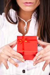 Red gift box in a woman's hand