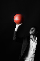 Young man holding basketball ball
