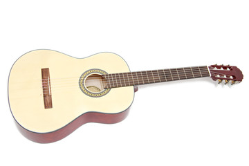 a yellow acoustic guitar isolated on white