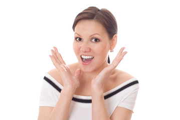 Excited woman with a surprised expression isolated on white.