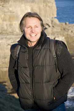 happy smiling outdoor man carrying rucksack