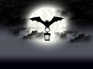 Flight bat on background of the full moon