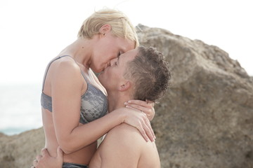 Passionate young couple on the beach