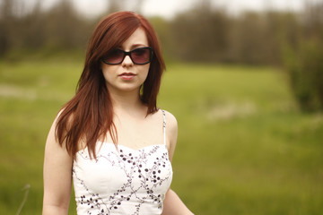 Portrait of a young and pretty woman with red hair