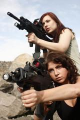 Sexy women with assault guns