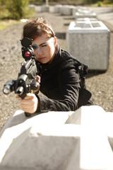 Sexy woman aiming rifle