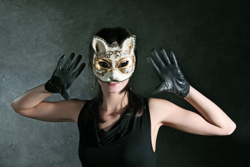 The young girl in the Venetian mask of a cat