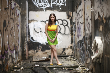 Young fashionable woman in abandoned building