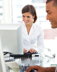 Two colleagues working at a their computer